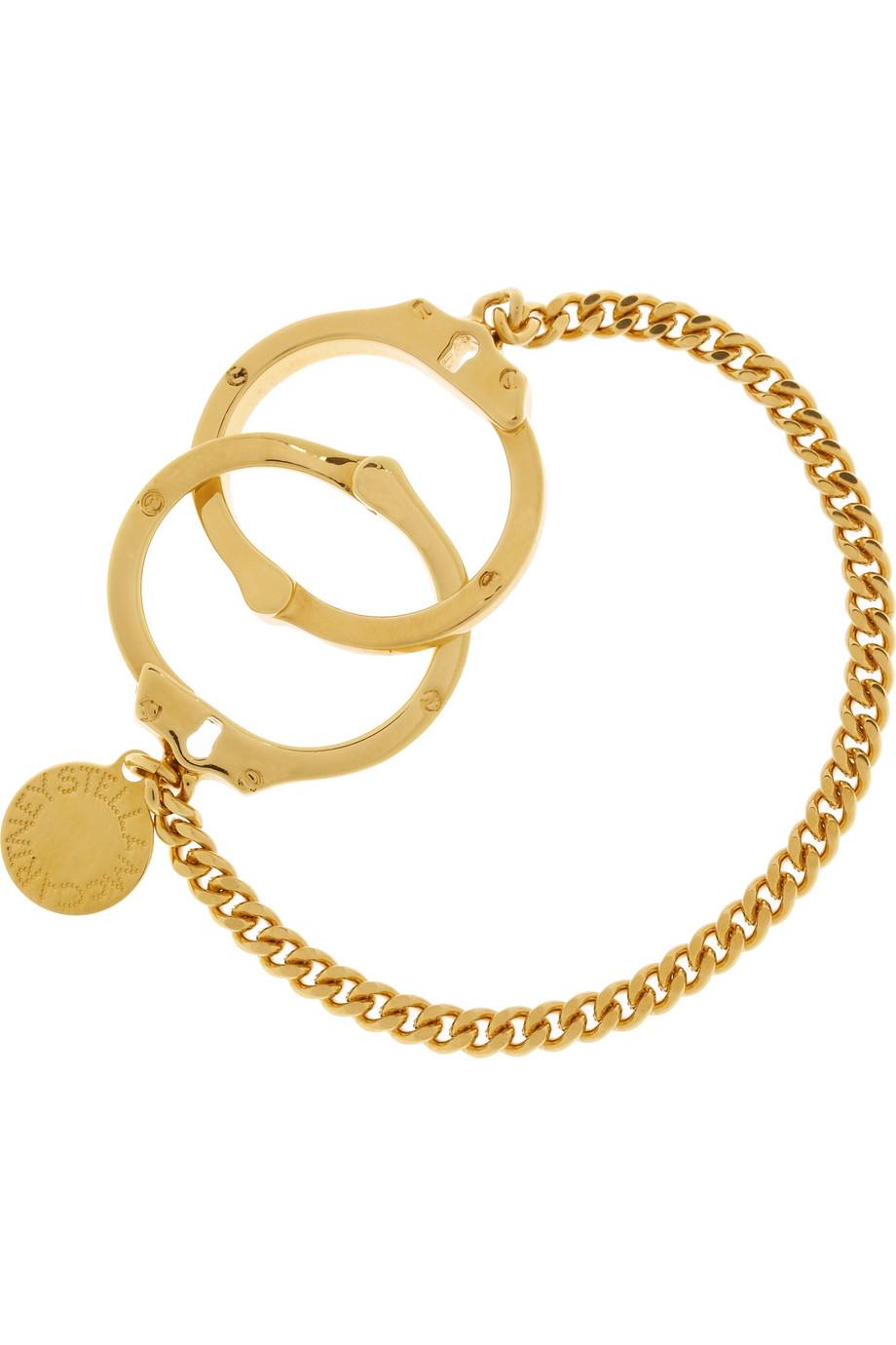 4a0787953e1b Stella McCartney  Pulsera dorada con forma de esposas